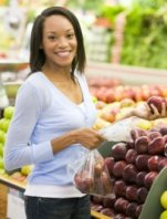 women buying apples at the grocery store