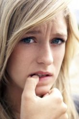 worried teen biting nail