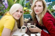 two female friends sharing coffee