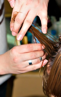 Hairstylist trimming hair