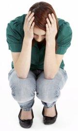 stressed-crouching-girl