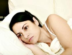 worried women in bed
