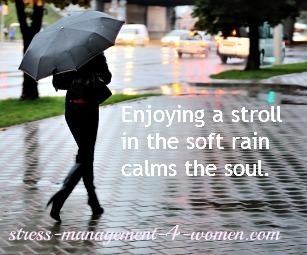 woman strolling in the rain with umbrella